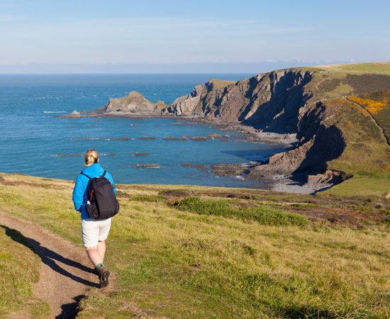 Walker at Hartland Quay on the South West Coast Path
